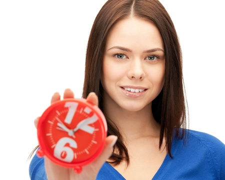 bright picture of woman holding alarm clock Stock Photo - 14730408