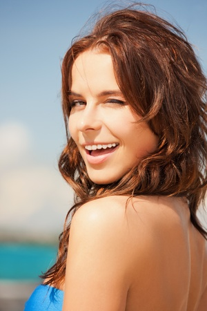 releaxed: bright picture of beautiful woman on a beach