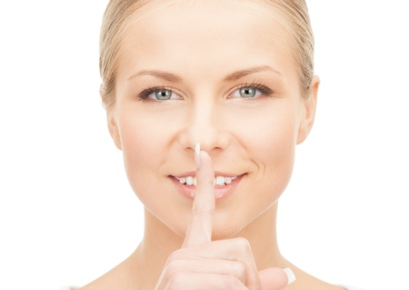 picture of happy woman with finger on lips Stock Photo - 14759005