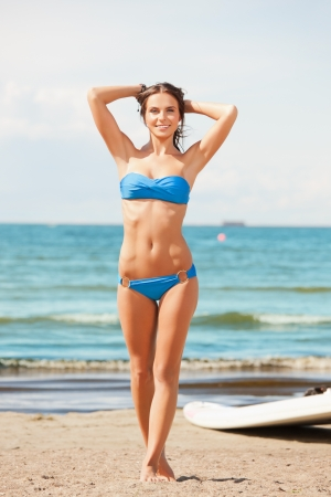 sexy bikini girl: picture of happy woman with wind surf on the beach  Stock Photo