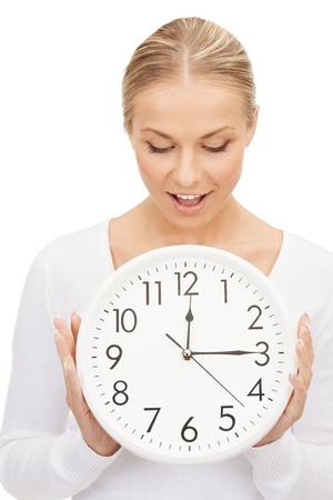 bright picture of woman holding big clock photo