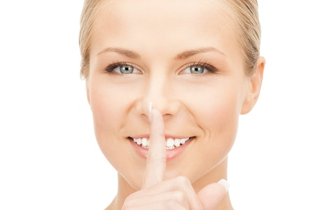 picture of happy woman with finger on lips Stock Photo - 14759756