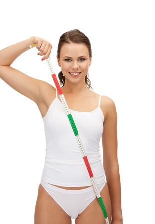 picture of young beautiful woman with measure tape photo
