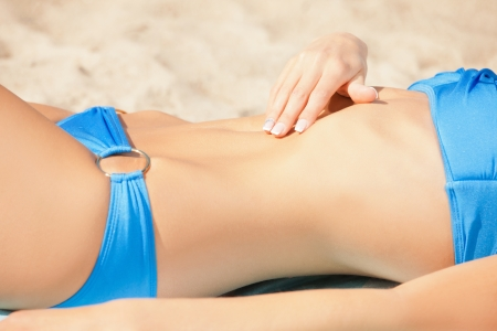 closeup picture of female belly and bikini   photo