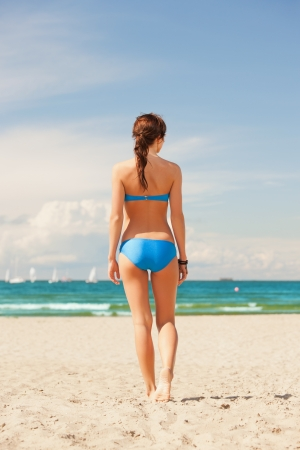 bright picture of woman on the beach  photo