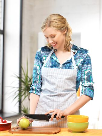 young knife: picture of beautiful woman in the kitchen   Stock Photo