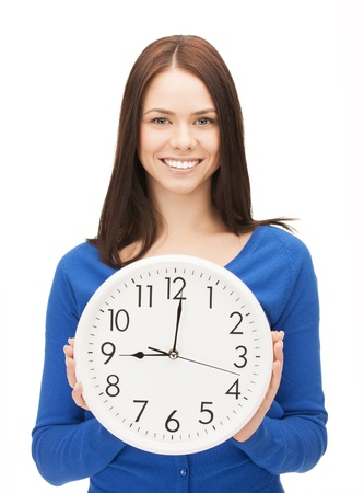 bright future: bright picture of woman holding big clock