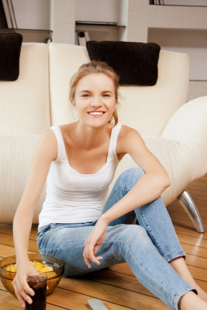 picture of smiling teenage girl with remote control photo