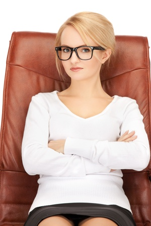 bright picture of businesswoman sitting in chair  photo