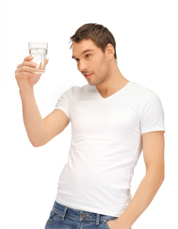 handsome man in white shirt with glass of water photo