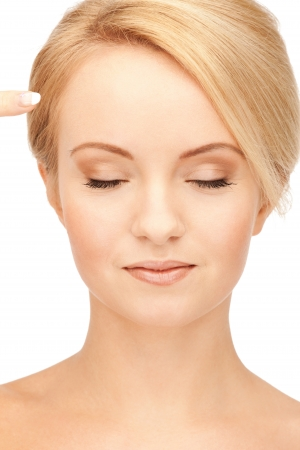 forehead: picture of beautiful woman pointing to forehead