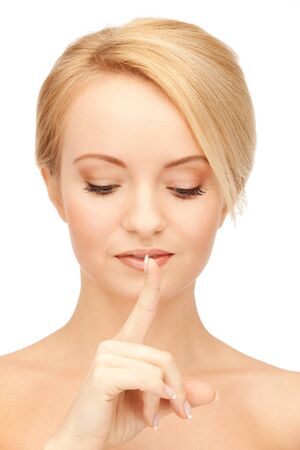 bright picture of woman with finger on lips Stock Photo - 15213968