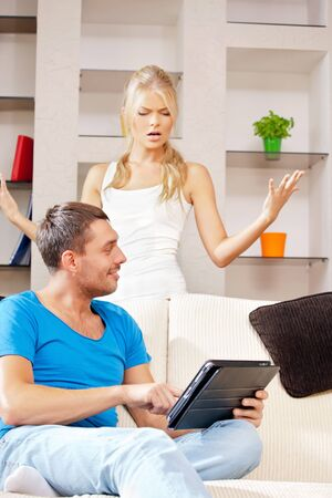 bright picture of couple with tablet PC  focus on man  photo