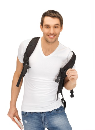 bright picture of travelling student with backpack and book photo