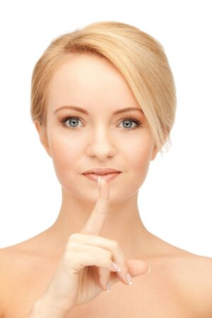 bright picture of woman with finger on lips Stock Photo - 15016650
