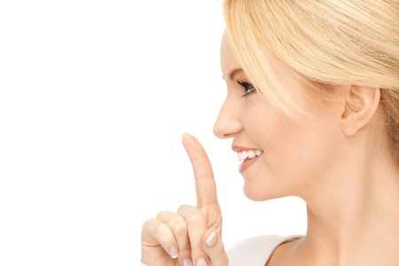 picture of happy woman with finger on lips Stock Photo - 15016633