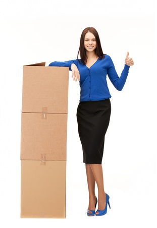 order delivery: picture of attractive businesswoman with big boxes