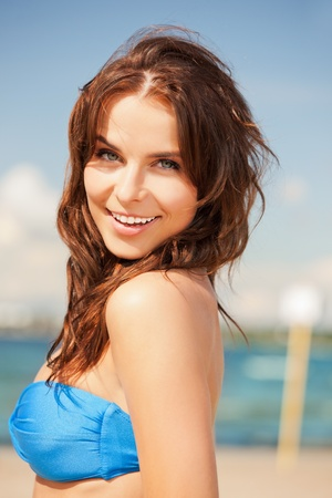 bright picture of happy smiling woman on the beach Stock Photo - 15016640