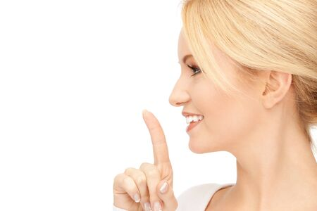 picture of happy woman with finger on lips Stock Photo - 15043675