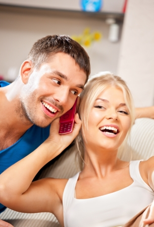 bright picture of happy couple with cellphone photo