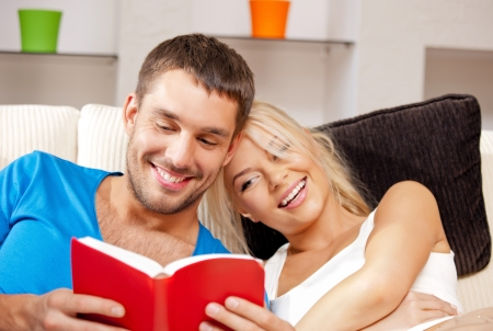 learning to read: bright picture of happy couple with book