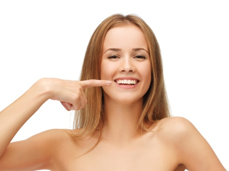 healthy mouth: picture of beautiful woman pointing to teeth