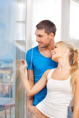 bright picture of happy couple at the window Stock Photo - 15043840