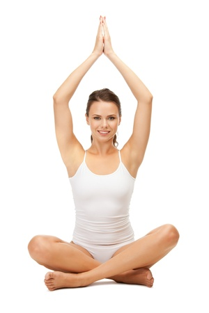 excercise: sporty woman in cotton undrewear practicing yoga lotus pose