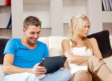 bright picture of couple with tablet PC photo