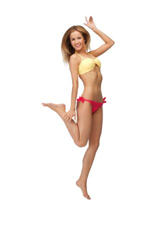 bright picture of jumping woman in bikini photo