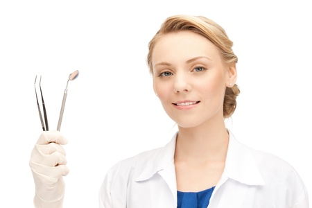 stomatologist: picture of attractive female dentist with tools     Stock Photo