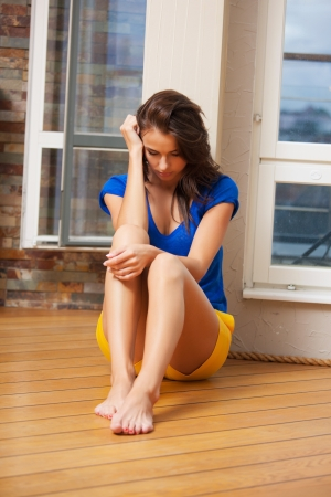 worried woman: bright picture of sad and lonely woman Stock Photo