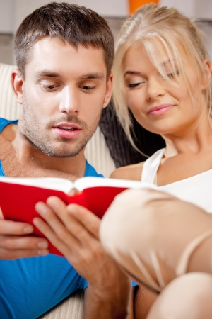 bright picture of happy couple with book Stock Photo - 15501312