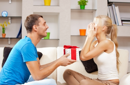 bright picture of happy romantic couple with gift  focus on man  Stock Photo - 15501206