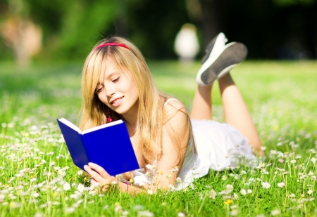outdoor picture of lovely teenage girl with book Stock Photo - 15501213