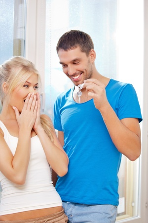bright picture of happy couple with keys Stock Photo - 15501219