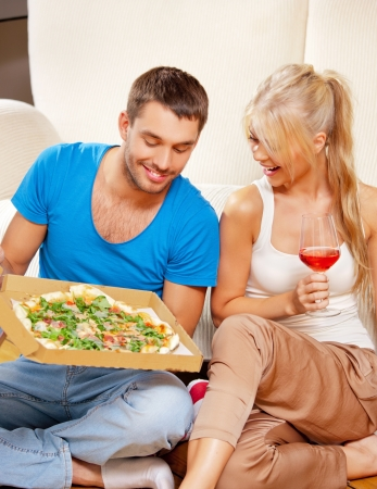 bright picture of happy romantic couple having dinner  focus on woman  photo
