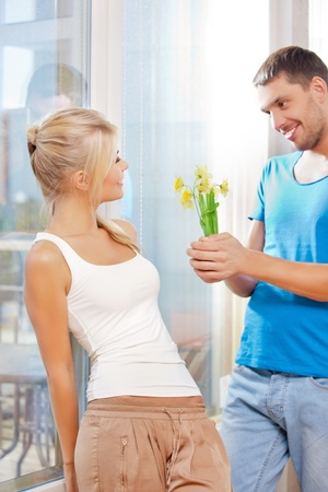 carrying: bright picture of happy romantic couple with flowers