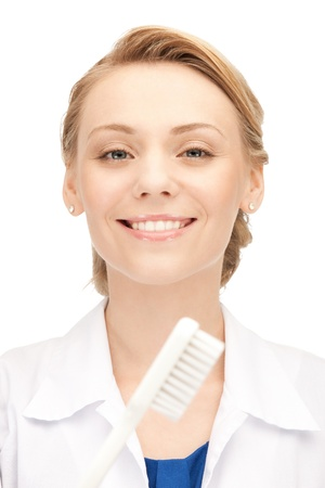 picture of attractive female doctor with toothbrush    Stock Photo - 15501311