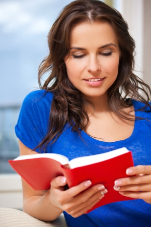 bright picture of happy and smiling woman with book   Stock Photo - 15501325
