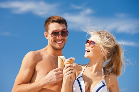 woman ice cream: bright picture of happy couple with ice cream