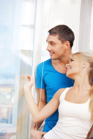 picture window: bright picture of happy couple at the window