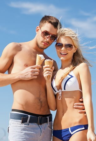 woman with ice cream: bright picture of happy couple with ice cream