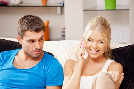 bright picture of couple with cellphone  focus on woman  photo