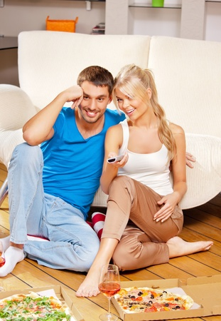 picture of happy romantic couple with remote photo