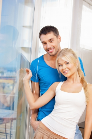bright picture of happy couple at the window Stock Photo - 15361716