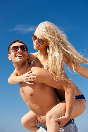 sunglasses beach: picture of happy couple in sunglasses on the beach  Stock Photo