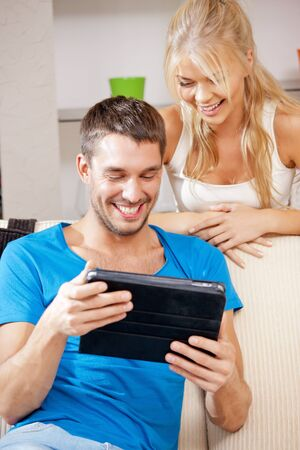 bright picture of happy couple with tablet PC photo