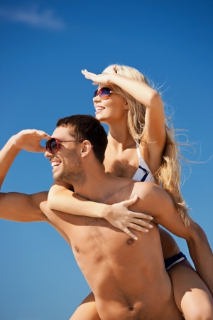 picture of happy couple in sunglasses on the beach  photo