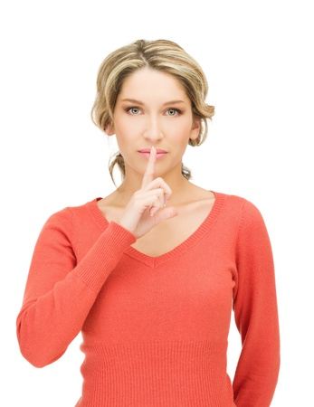bright picture of woman with finger on lips Stock Photo - 15399962